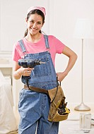 Woman using power tools at home