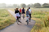 Family trip on bike. People biking through Nature Reserve The Schammer. The Schammer is a area of former farm landscape turned into nature and recreat...