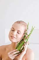 woman with aloe vera hair mask