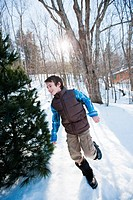 Boy running in snow