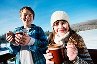 Children with hot drinks, portrait