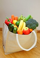 Shopping bag brimming with fresh fruit & vegetable
