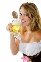 Woman in dirndl dress with beer mug