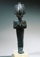 Egyptian civilization, Late Period. Mummiform figure of Osiris with arms crossed wearing Atef crown. Bronze statue, h. 21 cm.  Bologna, Museo Civico A...