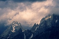 Sunlight on storm clouds near the summit of the Grand Tetons, Grand Teton Nat'l  Pk , WYOMING