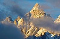 Sunrise light and clouds on the summit peak of the Grand Teton mountain, Grand Teton National Park, Wyoming