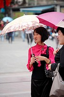 Instead of using sunscreen lotion umbrella become a essential fashion accessory  Kunming  China