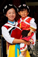 Mother and daughter from Naxi Ethinic group dressed in traditional costumes  Naxii is one of the 56 ethnic groups officially recognized by the Chinese...