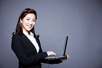 woman working by using laptop