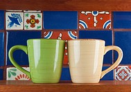 Cups in Front of Colorful Tile