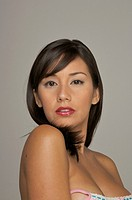Latin woman topless looking at camera with red lipstick