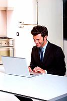 man in the kitchen with laptop
