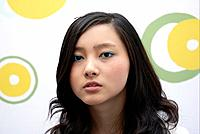 Cute young Asian woman in a funky modern office interior