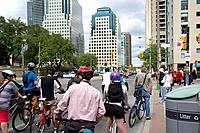 cyclists on queens quay west waiting at traffic lights toronto ontario canada