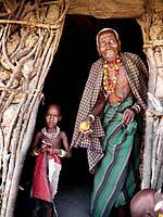 Grandmother and child in doorway of house, Watatulu tribesmen of Miyuguyu, Shinyanga district, Tanzania