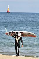 Busan (South Korea): man with a windsurf board at Haeundae Beach