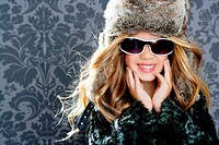 children fashion blond girl with fur winter coat sunglasses and hat