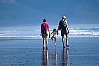 Family enjoying a summer afternoon at an Oregon beach