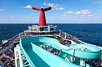 Cruise passengers on deck and waterslide on Carnival's Triumph cruise ship in the Gulf of Mexico
