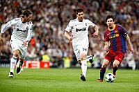 Messi with the ball marked by Xabi Alonso and Sergio Ramos, UEFA Champions League Semifinals game between Real Madrid and FC Barcelona, Bernabeu Stadi...