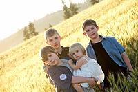 Three boys and their toddler sister in a barley field near Fairfield, Washington, in the Palouse.
