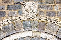 Chi-Rho on the cover of the Romanesque church of the Nativity of Durro - Vall de Boi - Pyrenees - Lleida Province - Catalonia - Spain