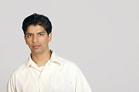 Studio shot of young pakistani man