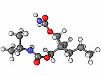 Carisoprodol muscle relaxant, molecular model. Atoms are represented as spheres and are colour_coded: carbon grey, hydrogen white, oxygen red and nitr...