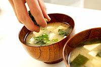 Woman making Miso soup, close up