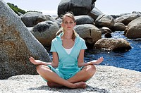 Young woman practicing yoga in a lotus position