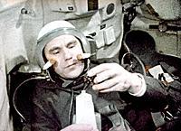 Vladimir Shatalov on Soyuz 4. Soviet cosmonaut Vladimir Aleksandrovich Shatalov born 1927 eating space food whilst in orbit on_board the Soyuz 4 space...