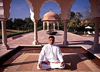 India, Rajastan, Jaipur, man doing yoga at Rajavilal
