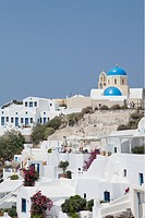 Village of Oia with blue_domed churches and whitewashed buildings, Santorini, Cyclades, Greek Islands, Greece, Europe