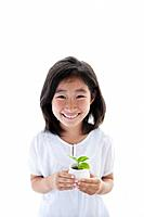 Young Girl Holding Potted Sprout