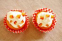 Orange muffins, close up, white background