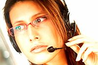 Young pretty woman wearing a phone headset. Call Centre Agent