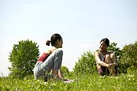 Two young women talking in a park