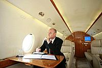 Businessman working in private jet