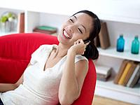 Mid Adult Woman Laughing on Phone