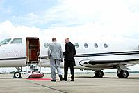 Businessmen walking towards private jet