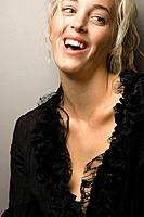 Pretty Caucasian woman smiling and looking to side.