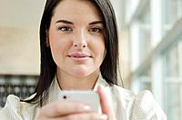 Portrait of smiling woman with mobile pone