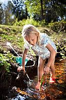Girl playing in creek