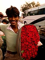 Man in India holding a bunch of roses