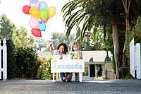 Girls 5_6 selling lemonade in front of house