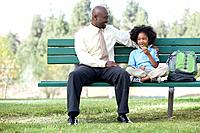 Father with son 7_9 sitting on bench in park