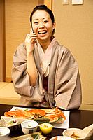 Woman talking on a mobile phone during a meal