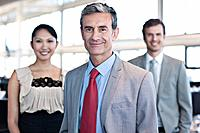 Portrait of middle_aged businessman and young business woman and man