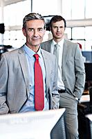 Portrait of middle_aged businessman and young business man