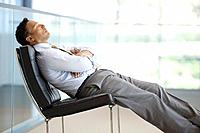Businessman resting in armchair
